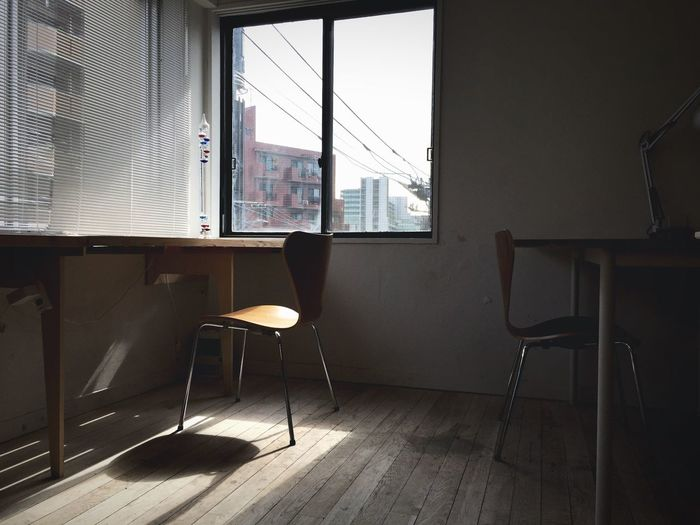 Chairs and tables in corner of office