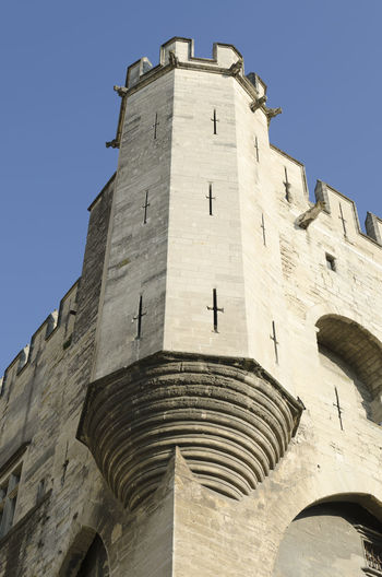 corner tower of palace of popes in Avignon, France Architecture Built Structure Low Angle View Building Exterior Sky The Past History Building Clear Sky No People Day Tower Religion Travel Destinations Spirituality Belief Place Of Worship Outdoors Palace Of The Popes Papal Palace Avignon Avignon, France France Provence