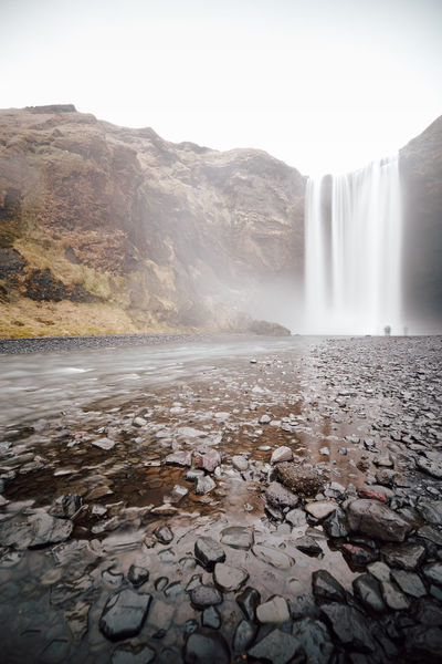 scenic view of the Skógafoss waterfall against sky in Iceland Eyjafjallajökull Volcano Iceland Iceland Memories Beauty In Nature Day Environment Flowing Flowing Water Hot Spring Iceland Trip Long Exposure Motion Mountain Nature No People Non-urban Scene Outdoors Philipp Dase Power In Nature Rock Scenics - Nature Skogafoss Skogafoss Falls, Iceland Skogafoss Waterfall Skogar Skogås Sky Solid Tranquil Scene Water Waterfall