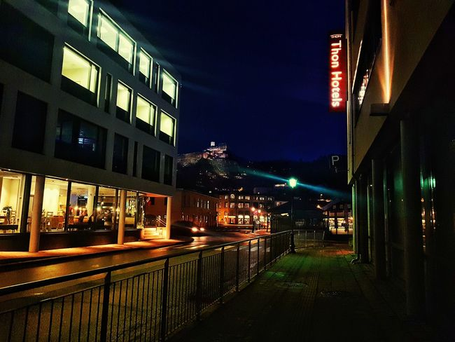 Halden, Norway with fortress lit up in background, center left. Samsung Samsungphotography Samsung Galaxy S7 City Life Cityscape City Street City Lights City View  Fortress Fortress In Europe Winter Wintertime Halden Halden, Norway Norway Norway🇳🇴 Norway ✌ Hotel Restuarant Restaurant Night Illuminated Architecture Building Exterior City Built Structure Nightlife Street Light
