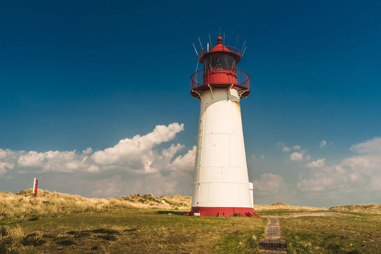 Architecture Building Building Exterior Built Structure Cloud - Sky Day Direction Field Guidance Land Lighthouse Nature No People Outdoors Protection Red Safety Security Sky Sylt Tower
