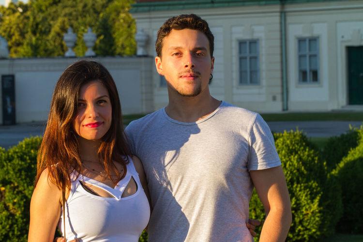 Portrait Of Young Couple Against Building