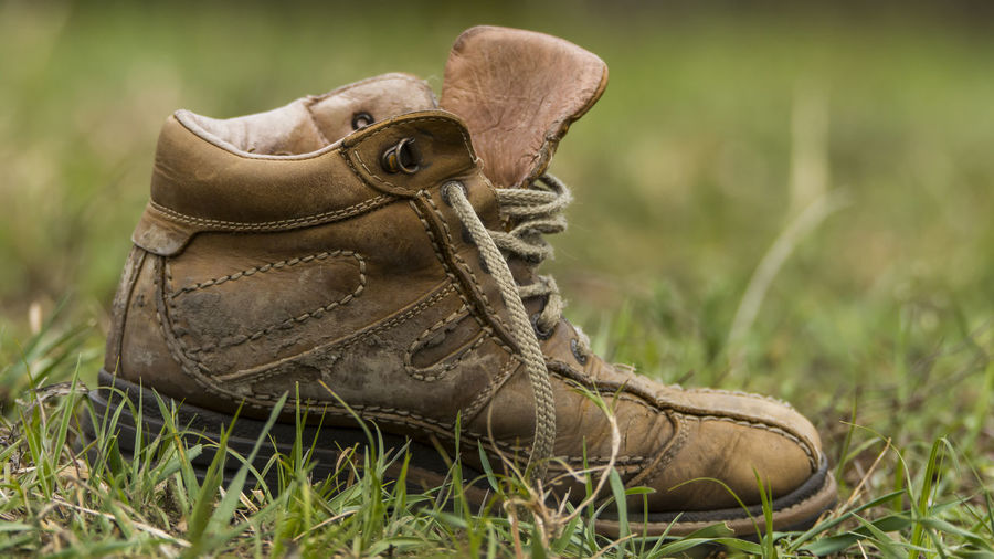 Close-Up Of Shoe On Grassy Field