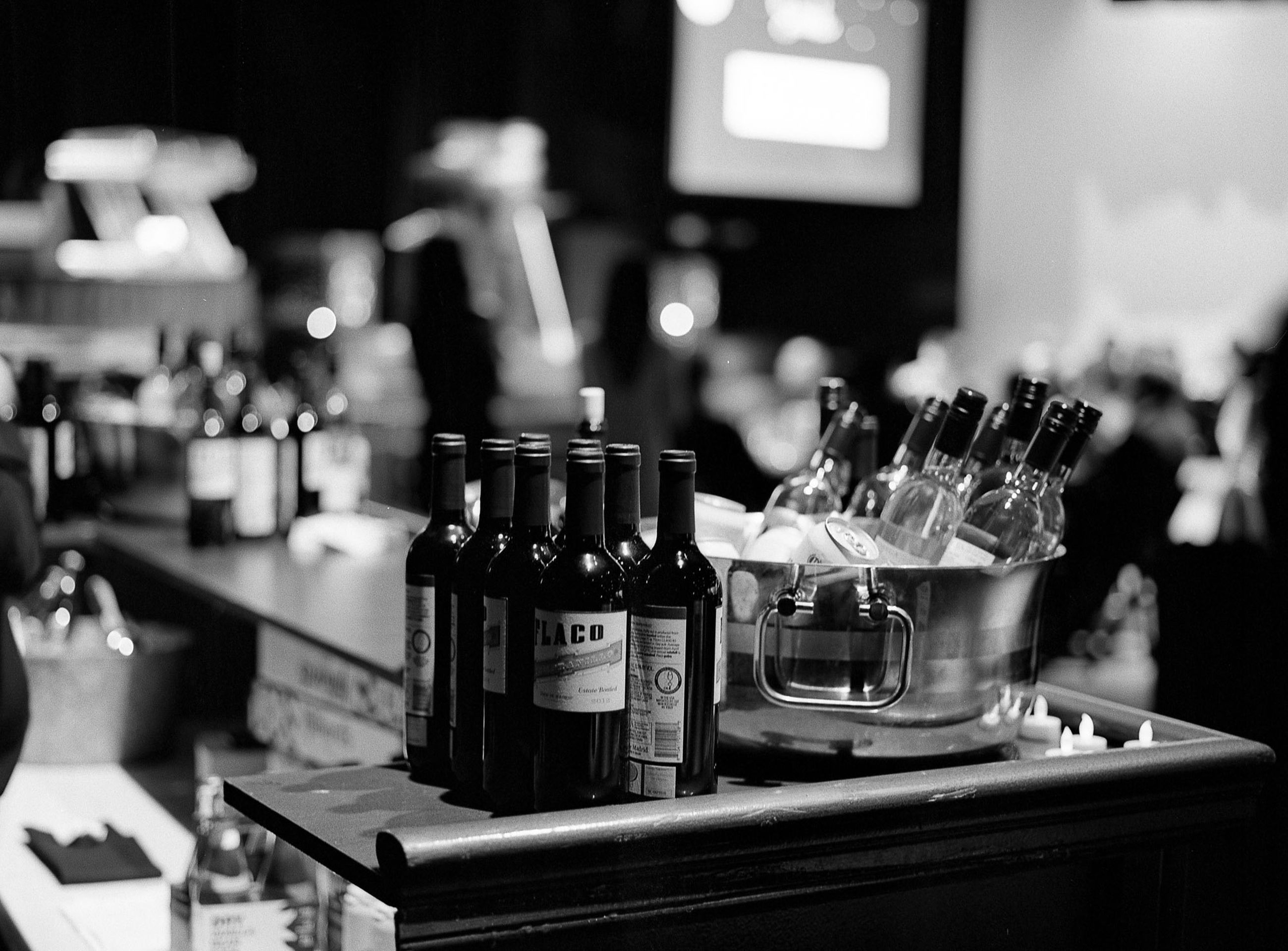 indoors, table, focus on foreground, still life, close-up, selective focus, food and drink, technology, candle, home interior, no people, large group of objects, shelf, variation, bottle, illuminated, restaurant, arrangement, domestic kitchen, music