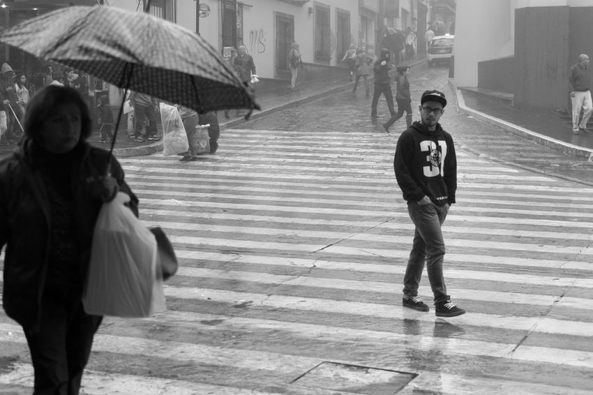 Architecture Built Structure Casual Clothing Cold Days Front View Full Length Here Belongs To Me Leisure Activity Lifestyles Looking At Camera Monochrome Person Portrait Rainy Days Standing Streetphoto_bw Streetphotography Togetherness Umbrella Urban Life Urban Lifestyle Urbanphotography Wet Young Adult