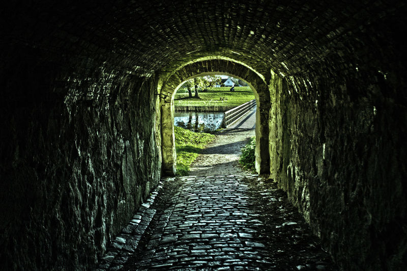 Tunnel from 1734 in the old city of Fredrikstad. EyeEm Gallery The Week On EyeEm Arch Architecture Built Structure Day Indoors  Nature No People The Way Forward Tree Tunnel Water