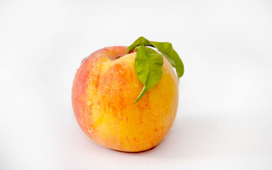 single fresh peach isolated on a white background Agriculture Fresh Produce Hello World Nature Summertime USA Vitamins Close-up Food Fresh Fruit Healthy Eating Juicy Just Picked Michigan Peaches Natura' Organic Peach Peaches Produce Studio Shot Sweet Tasty Wellbeing Yellow