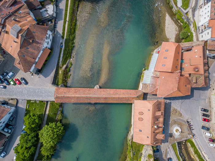 High Angle View Of Covered Bridge Over River In City