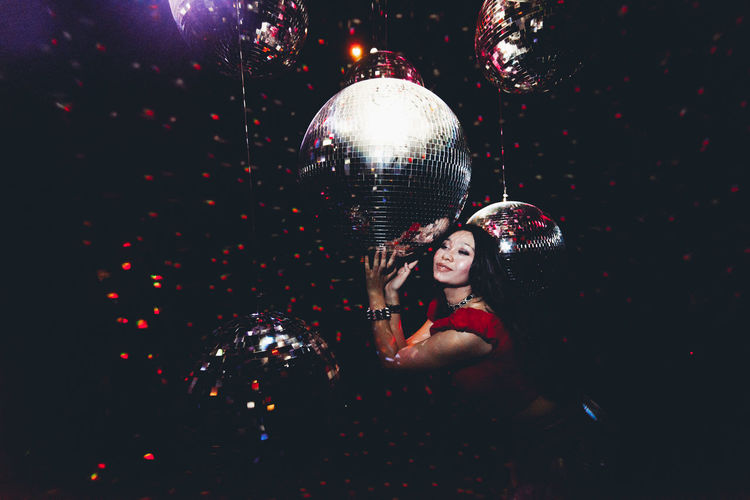 One Person Disco Ball Illuminated Indoors  Celebration Night Holding Women Young Adult Decoration Adult Balloon Young Women Portrait Beautiful Woman Shiny Event Waist Up Beauty Nightlife Light Hairstyle