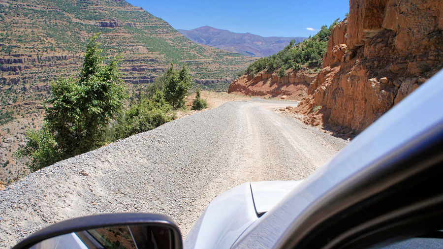Gravel road through the Taurus Mountains, Turkey Road Turkey Arid Climate Beauty In Nature Car Car Interior Day Gravel Land Vehicle Landscape Mode Of Transport Mountain Nature No People Outdoors Road Scenics Sky Taurus Taurus Mountains The Way Forward Tranquility Transportation Window