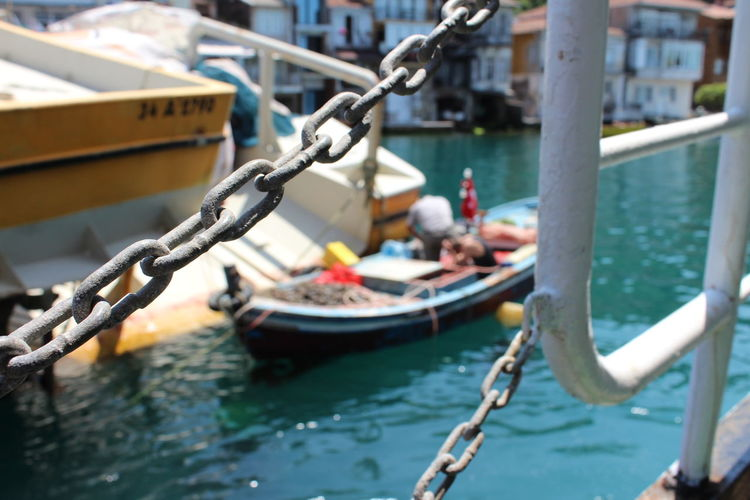 Scenic view of harbor from a ship with a chain link