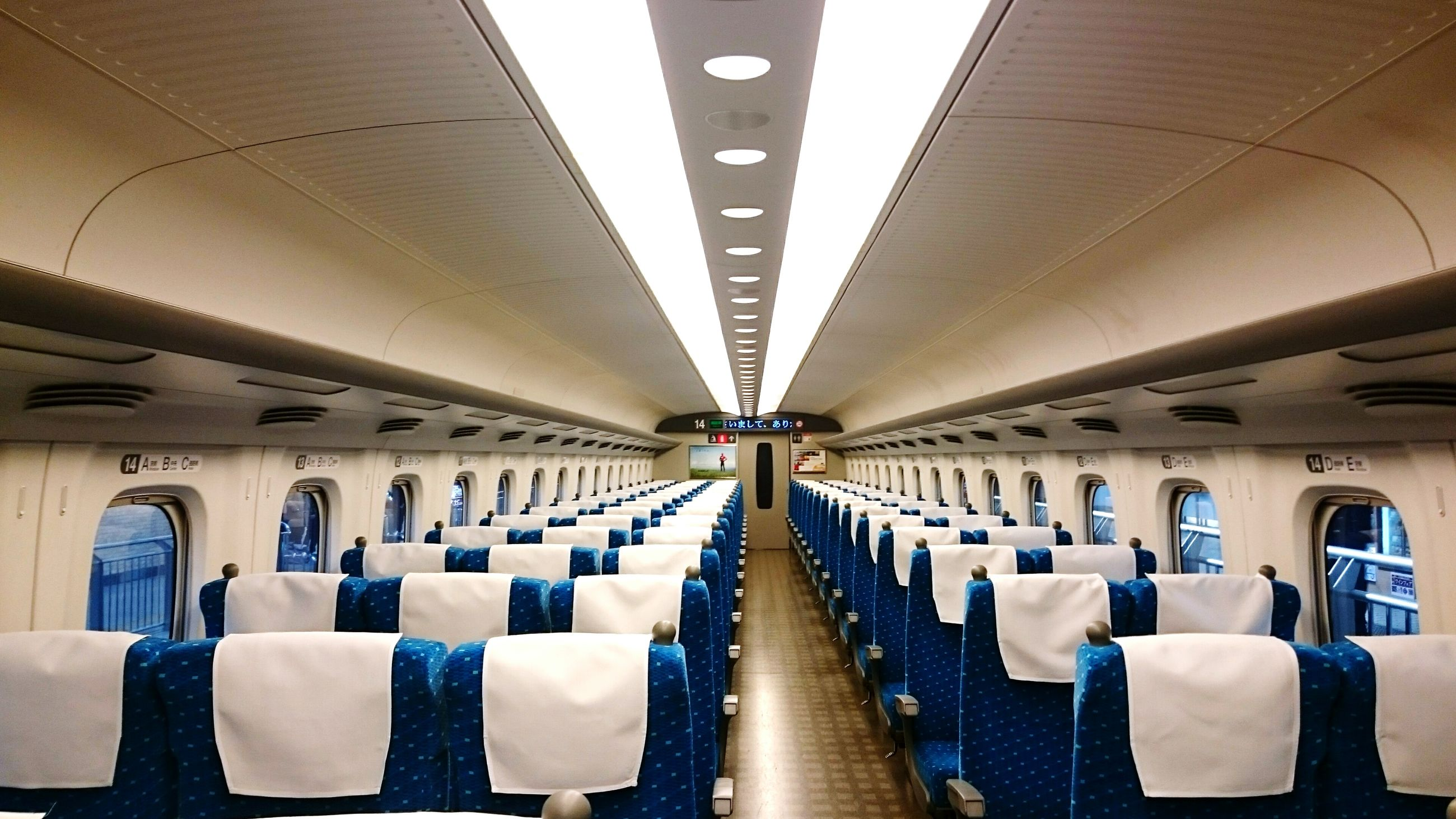 indoors, transportation, in a row, public transportation, mode of transport, vehicle interior, vehicle seat, travel, train - vehicle, ceiling, empty, railroad station, seat, rail transportation, interior, passenger train, journey, architectural column, modern, airport