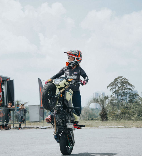 Stunt Motorcycle Riding Headwear One Person Transportation Adults Only Crash Helmet Biker Mode Of Transport People Only Women Day Outdoors Sports Helmet Adult Speed Motocross Road Sky Helmet Stuntbikes Stuntshow Malaysia