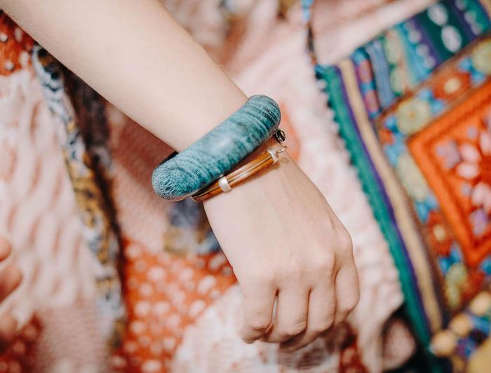 Female hand with a blue boho bracelet