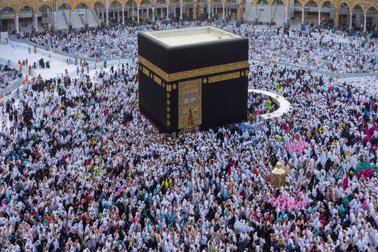 "MECCA, SAUDI ARABIA - 20TH NOV 2017; Muslim pilgrims circumambulate or ""tawaf"" the Kaabah after Subuh prayer at Masjidil Haram, Makkah, Saudi Arabia. Cube Pray Prophet Abraham Prophet Muhammad Saudi Arabia Tawaf Unity Black Blessed  Circumambulate Crowd Holy Place Humble Ihram Kaaba Mecca Al-mukarramah Multi Racial Muslim People Pilgrims Purify Religion Round White Zam Zam Water"