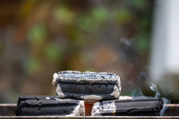Close-up of charcoal stack burning
