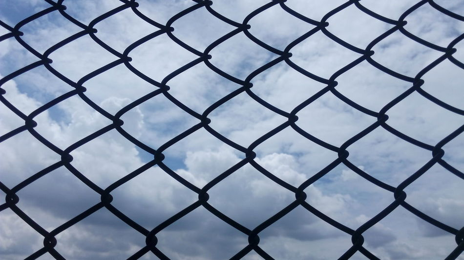 Protection Safety Security Fence Full Frame Backgrounds Chainlink Fence Pattern Sky Close-up Focus On Foreground Day Outdoors Fragility Blue Beauty In Nature Tranquil Scene Scenics No People Clounds  Clounds And Sky