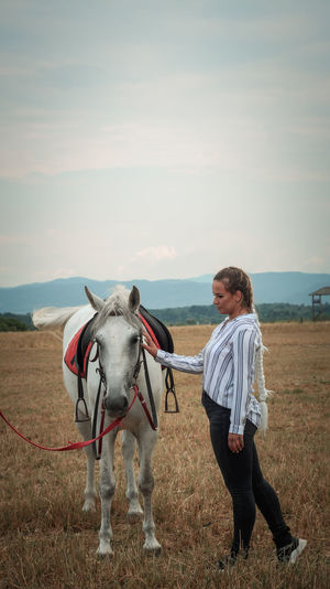 Full length of a horse on a field