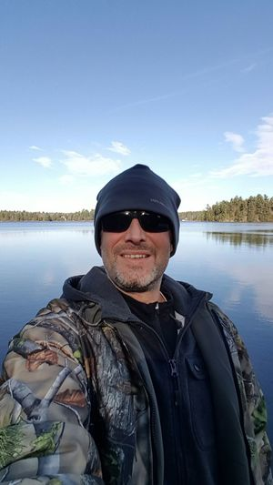 Enjoy The New Normal Only Men One Man Only Portrait Water One Person Reflection Looking At Camera Hat Lake Sunglasses Outdoors Nature