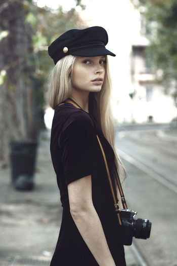 Hat One Person Portrait One Woman Only Adult Only Women Individuality Adults Only Beautiful People Young Adult Young Women One Young Woman Only Beautiful Woman Gun People Women Outdoors Old-fashioned Blond Hair Fashion The Week On EyeEm
