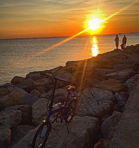 Sunset Sea Full Length Sun Rock - Object Vacations Togetherness Two People Adult People Nature Sunlight Beach Leisure Activity Beauty In Nature Horizon Over Water Travel Destinations Scenics Outdoors Water