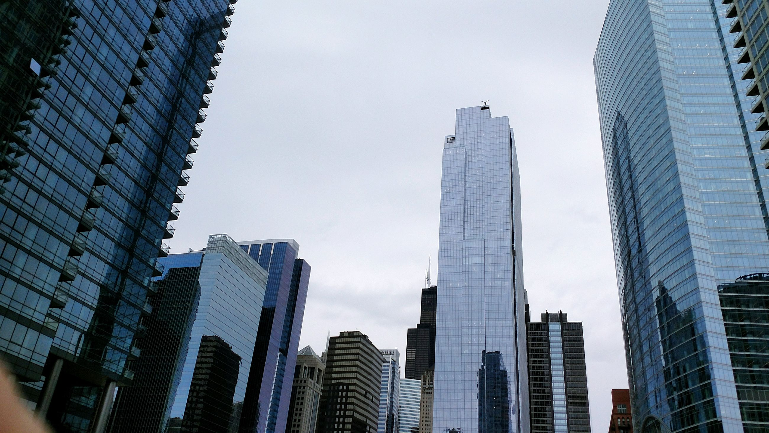 skyscraper, architecture, building exterior, built structure, modern, city, low angle view, sky, outdoors, day, downtown district, no people, tall, urban skyline, office park, cityscape