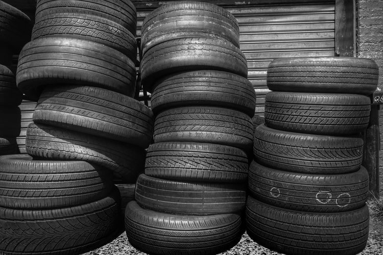 Black and white shot of pyle of tyres