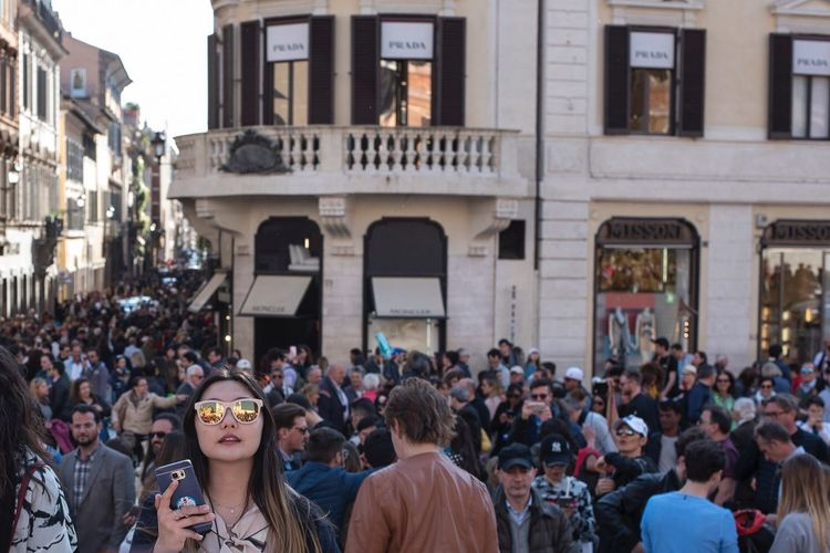 Chinese girl in the crowd Large Group Of People Crowd Real People Building Exterior Built Structure Architecture Moving Around Rome Women Arts Culture And Entertainment City People Outdoors Sky Adult