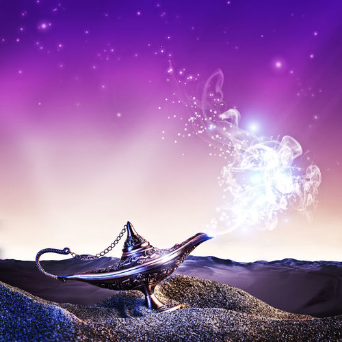 Close-Up Of Magic Lamp Against Purple Sky