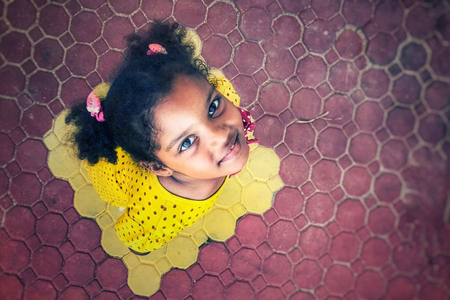 Children People Watching People Portrait People Photography Faces Of EyeEm Portrait Photography people and places Shadows & Lights Light Textures and Surfaces EyeEm ready EyeEm Gallery EyeEm Best Shots From My Point Of View EyeEmBestPics One Person Looking At Camera Portrait Close-up Women Headshot Child Childhood Beauty Yellow Front View Smiling Pattern The Portraitist - 2018 EyeEm Awards #urbanana: The Urban Playground