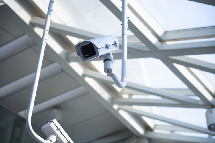 Security Camera Surveillance Technology No People Built Structure Low Angle View Security System Security Focus On Foreground Safety Day Architecture Protection Metal Photography Themes Camera - Photographic Equipment Outdoors Connection Control Modern Ceiling