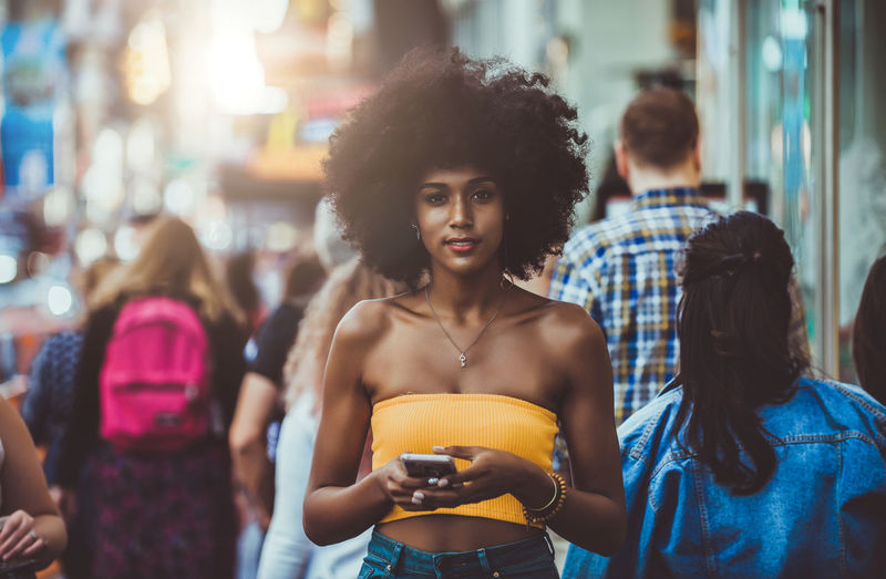 Beautiful woman spending time in new york city Woman Portrait Lifestyles Walking New York Urban City Time Square, New York Technology New Yorker American Manhattan Crowd People Citizenship Concept Crossing Street person Girl Beautiful Smile Fast Smartphone Matrix