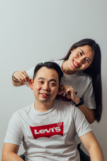 Front View Emotion Portrait Looking At Camera Smiling Indoors  Happiness Standing Casual Clothing Two People Togetherness Waist Up Men Males  Young Adult People Studio Shot Lifestyles Positive Emotion Levis LEVIS™ Couple Love