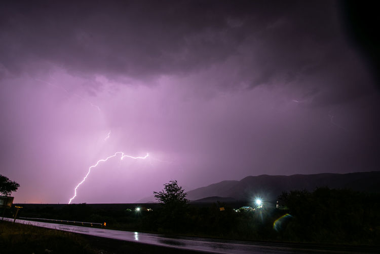 Lightning Power In Nature Storm Night Thunderstorm Cloud - Sky Power Sky Beauty In Nature Storm Cloud Illuminated Sign Forked Lightning Warning Sign No People Nature Dramatic Sky Electricity  Purple Outdoors Ominous Dark Extreme Weather