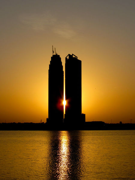 Low Sun Effect Low Sunlight Sharjah Sharjah Uae Sunset Cityscape City View  Man Made Vs Nature Sunset Silhouette Water Reflections Architecture Built Structure Nature No People Orange Color Reflection Silhouette Sky Sun Travel Destinations Water Waterfront EyeEmNewHere