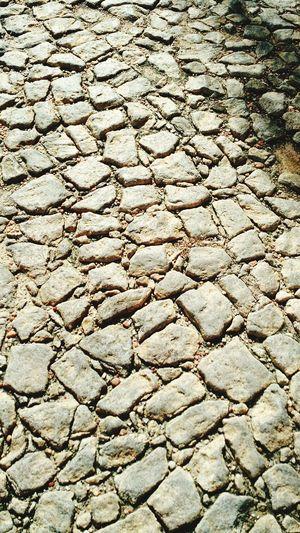 Simples estradas infinitamente persistentes ao tempo. Roads Stone History Stones City Culture Historical