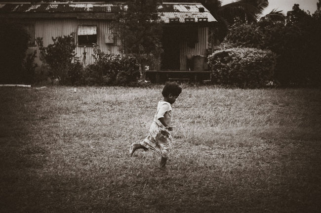 Little runner in B&W Black And White Child Childhood Children Only Day Fiji Full Length Girl Grass Motion Nature Nausori Highlands One Person Outdoors Playing Real People Running Village The Street Photographer - 2017 EyeEm Awards