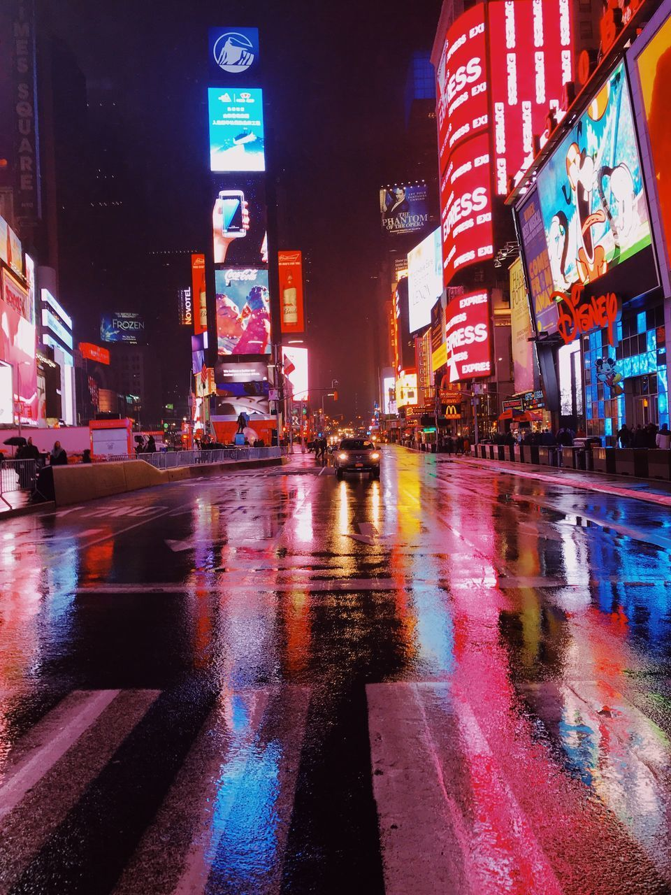 illuminated, rain, night, wet, street, road, architecture, building exterior, city, outdoors, city life, built structure, travel destinations, multi colored, neon, no people