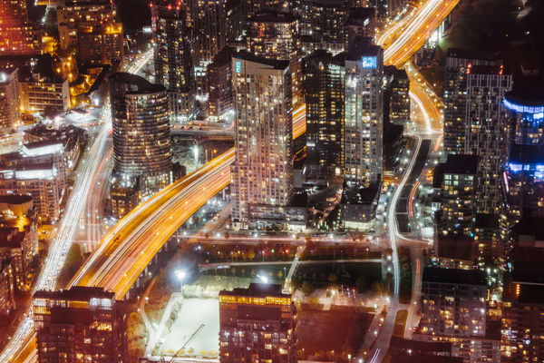 Mobility In Mega Cities Architecture Building Exterior Built Structure City City Life Cityscape Growth High Angle View Illuminated Light Trail Long Exposure Modern Motion Night No People Outdoors Road Skyscraper Speed Travel Destinations Urban Skyline
