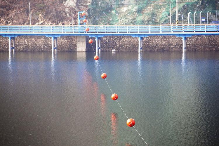 Buoys hanging over lake