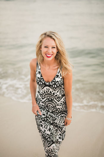 A beautiful blonde woman at the beach. Beach Blond Hair Hair Beautiful Woman Land Smiling Sea Water Young Adult One Person Beauty Looking At Camera Happiness Women Portrait Front View Hairstyle Outdoors