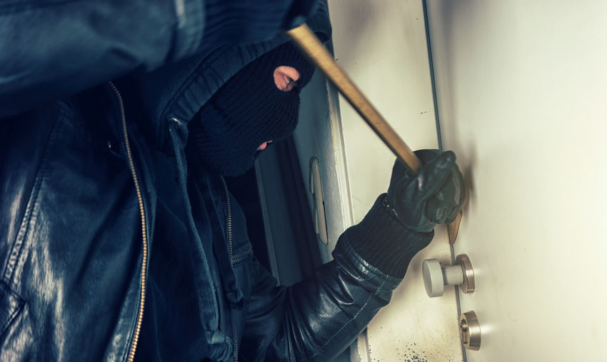 Burglar breaking in to a house door with crowbar Agressive Business Crime Crime Scene Crowbar Leverage Lifestyle Motion Blur Victim Burglar Burglary Gangster Gangstershit Gloves Hoodie House Door Human Body Part Intruder  Light And Shadow Mask Motion Night One Man Only One Person Police
