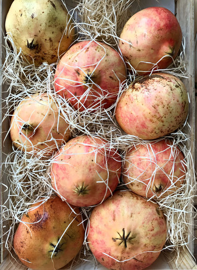 Box of pomegranates, granadas, at grocery store Box Close-up Day Display Food Food And Drink Freshness Granadas Groceries Grocery Store Healthy Eating No People Pomagranate Red Color