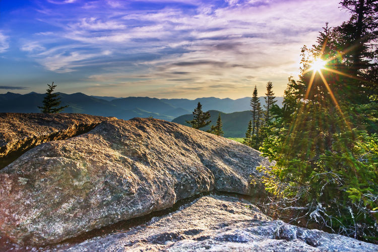 Panoramic view of rocks against sky during sunset