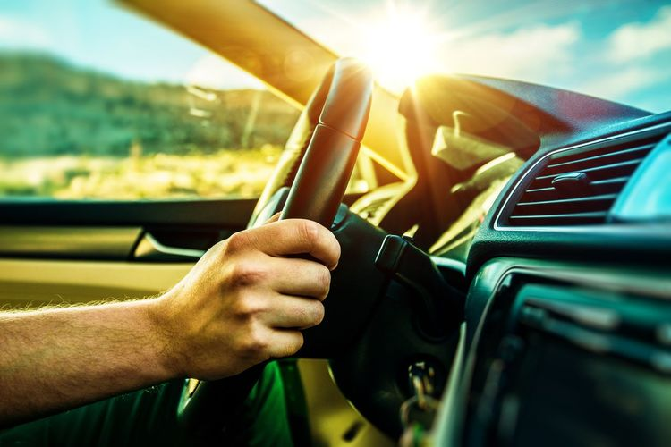 Scenic Drive Concept. Modern Car Interior. Adult Car Car Interior Close-up Day Drive Driver Driving Human Body Part Human Hand Land Vehicle Men Mode Of Transport One Person Outdoors People Real People Road Trip Sky Steering Wheel Sunlight Transportation