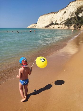 Costa Sud - Sicilia Sea Childhood Water Beach Full Length Elementary Age Cute Boys Person Shore Girls Playing Tranquil Scene Casual Clothing Summer Innocence Clear Sky Coastline Tranquility Family Always Be Cozy Enjoying Life Fun Enjoying The Sun