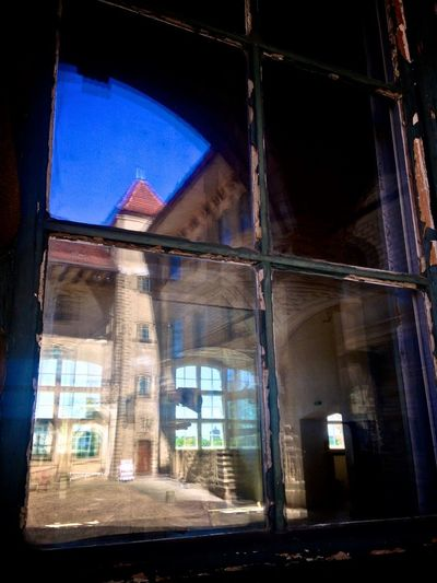 Reflection Abandoned Architecture Broken Building Building Exterior Built Structure Damaged Day Glass Glass - Material Low Angle View Misfortune Nature No People Outdoors Reflection Sunlight Transparent Window Window Frame Windowreflection