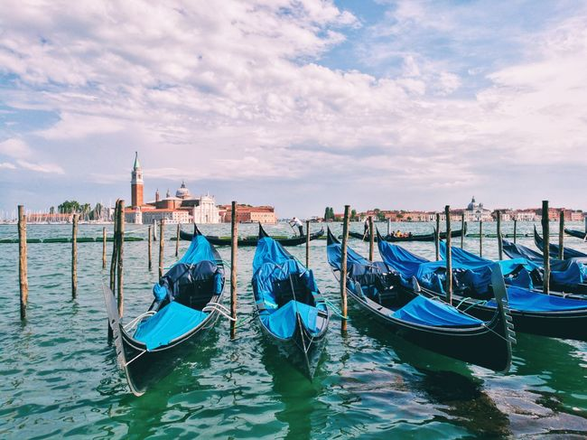 Gondola - Traditional Boat Travel Destinations No People Water Outdoors Day Tourism Blue Holidays Blue Sky Summer Scenics Travelling Building Exterior Architecture Lake Chanel Romantic City Venice, Italy Lifestyles Leisure Activity Boat Sea Clouds And Sky Tower Sommergefühle