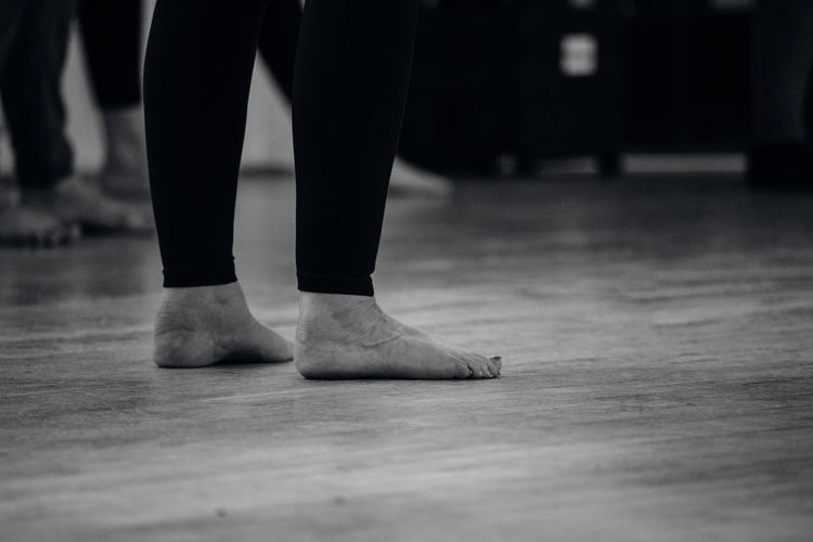 Low Section Body Part Human Body Part Human Leg One Person Flooring Standing Indoors  barefoot Human Foot Ballet Dancer Dancing Real People Ballet Limb Performance Tiptoe Lifestyles Human Limb Stage