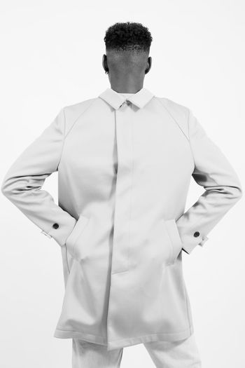 Rear View Of Man Wearing Jacket Against White Background